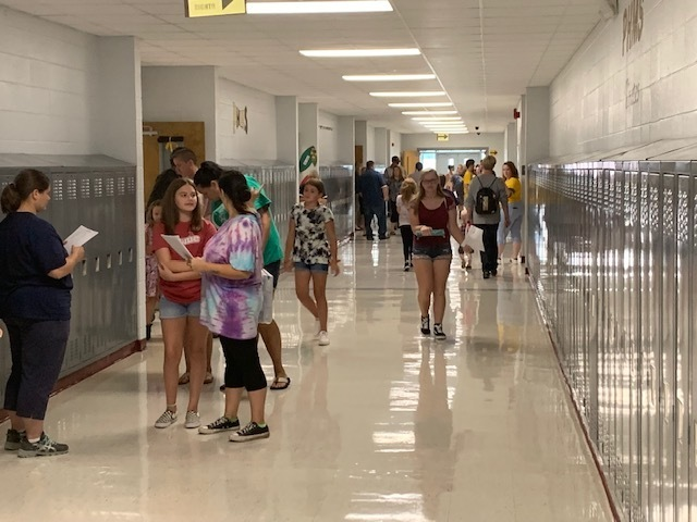 Students walking in the hallway at Back to School Night