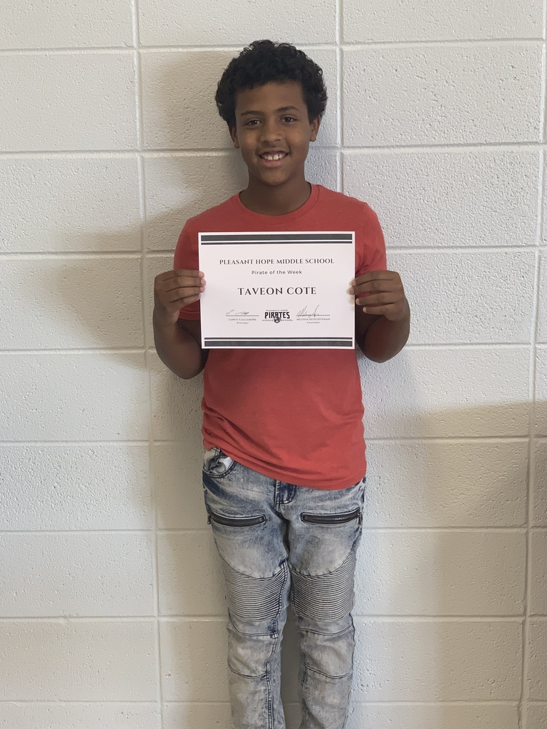Taveon standing with a certificate.