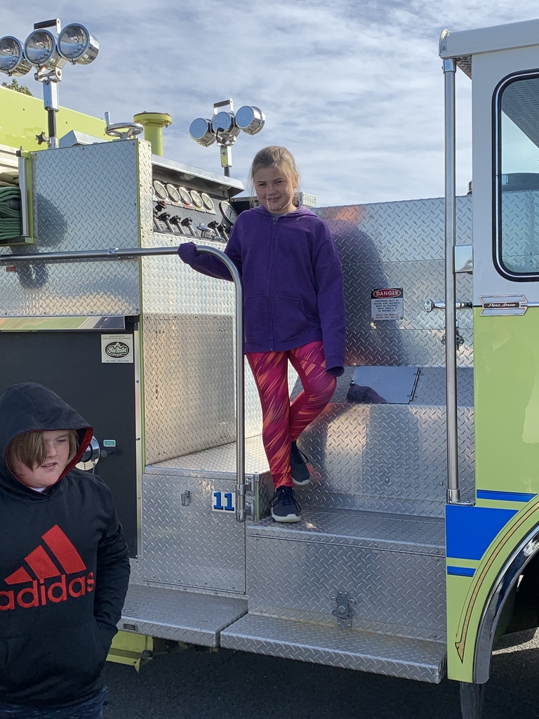 Getting a tour of the fire truck.