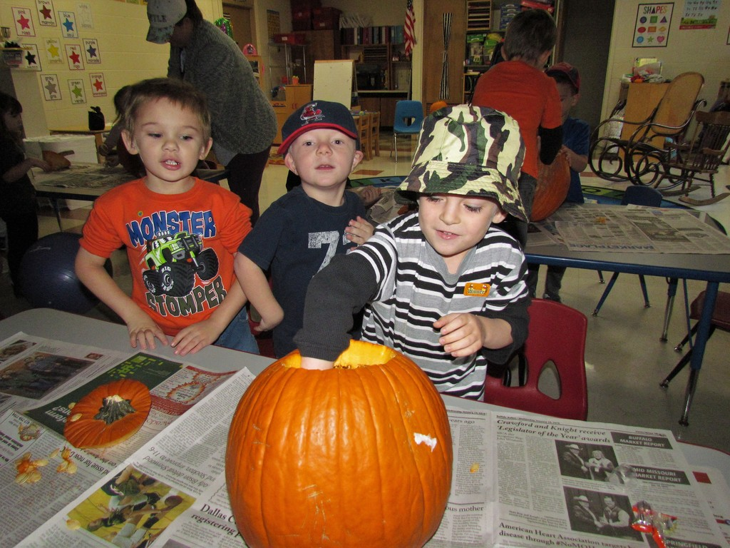 Ooey Gooey pumpkin carving fun in AM preschool!