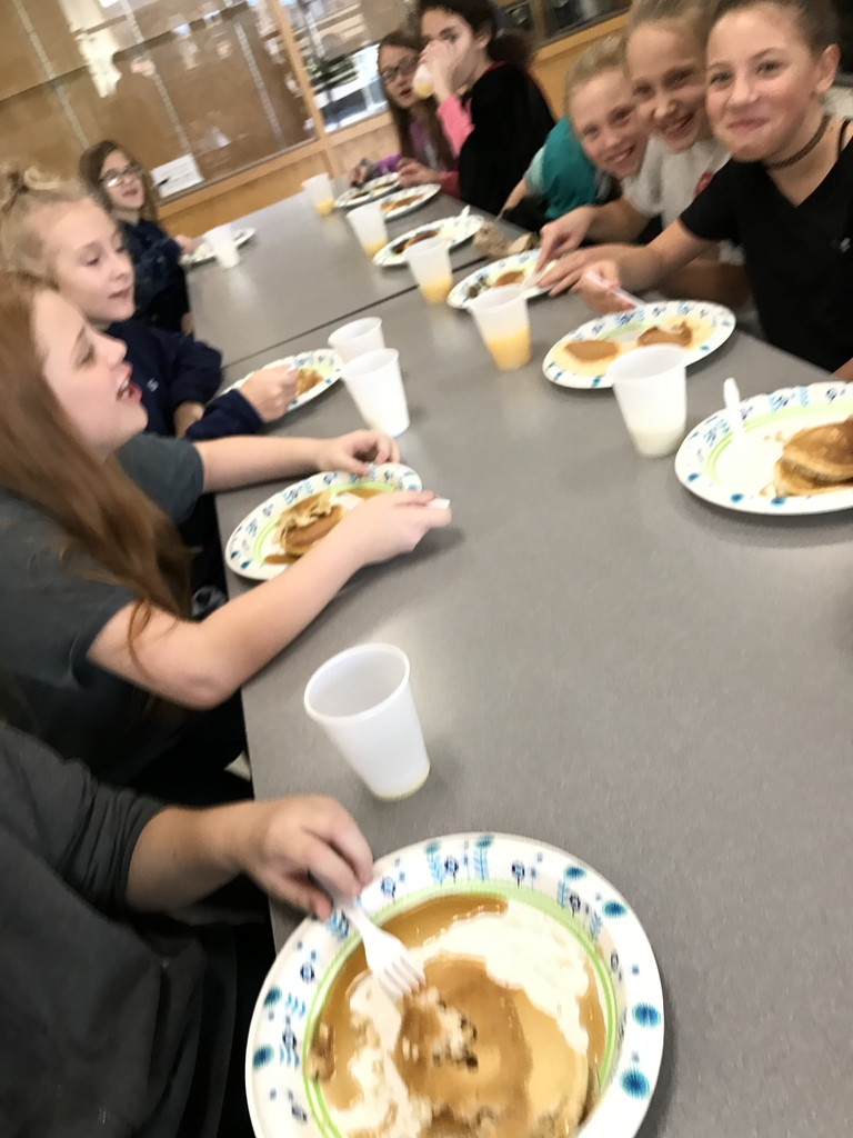 Students eating pancakes